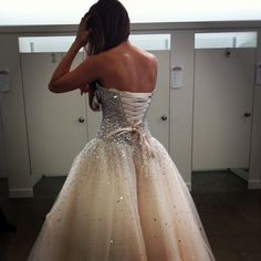 HOLY CRAP IT'S SO PRETTY I LOVE THE COLOR AND THE SPARKLES AND THE LACE-UP BACK