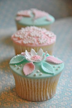 Soft mint and pink cupcakes with different toppings.#mint #wedding #theme