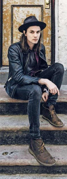 Like the style of the leather jacket, the dark hue of the jeans, and the use of thick-looking boots.