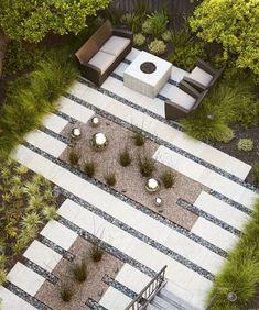 mobilier élégant, ardoises et galets gris dans le jardin moderne