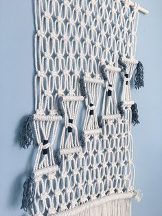 Unique handmade macrame wall hanging. Featuring a geometric 'stairway' design and finished with dense fringing. This piece is 60cm wide and 100cm long. Handmade in London, using natural cotton rope. For custom lengths and designs feel free to message me. You can find more of my work