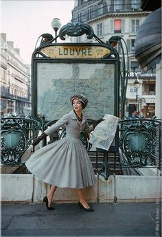 Model wearing dress by Christian Dior  Photographed by Mark Shaw, 1957