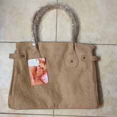"""Never worn Jessica Simpson Faux suede tan purse Never worn Jessica Simpson Faux suede tan purse. Front has a texture design, new with tags, plastic still on handles.  15"""" x 11 x 4 Jessica Simpson Bags"""