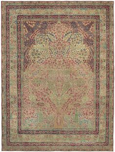 """LAVER KIRMAN 'TREE OF LIFE', Southeast Persian 9ft 8in x 12ft 8in Circa 1850  At more than 160 years old, this awe-inspiring antique Persian rug features an entrancing """"Tree of Life"""" design treasured by rug connoisseurs. Each diminutive blossom and bough is rendered with exquisite clarity, as the forms combine to ascend into a scalloped arch. Its tremendous sophistication and rare, deeply patinaed hues would create a beguiling ambiance in a formal environment."""