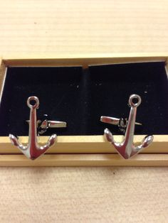 A pair of anchor shaped stainless steel cufflinks.  Priced at $58.  CNY special at $38 if purchase made on or before Jan 31.