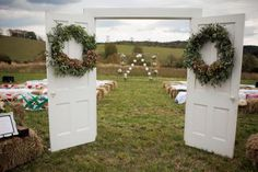 While this wedding is outdoors, the feel is that of a rustic barn. Create a surprising entry to the altar by bringing indoor elements outside to define the space. Floral designer Janie Medley accessorized the doors with wreaths made with seeded eucalyptus and green hydrangeas.