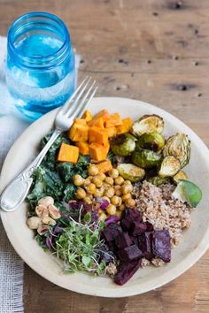 Kale with grain roasted brussels, sweet potato, beet, chickpeas, sprouts, almond and avocado lime dressing