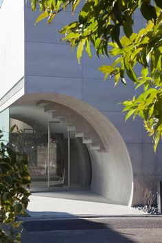 A concrete tunnel slices through the base of this Tokyo house.
