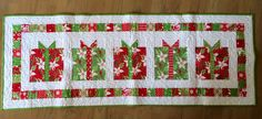 Presents table runner - Flurry fabrics - quilted by Bobby Hyland