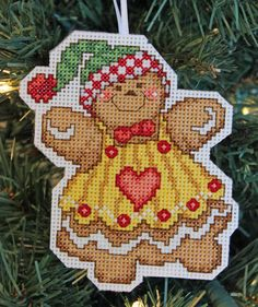 A personal favorite from my Etsy shop https://www.etsy.com/ca/listing/288088707/handmade-cross-stitch-gingerbread-girl