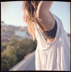 love this tattoo. i want one. underneath my rib tattoo maybe?