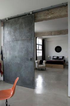 polished concrete floors and steel barn door -- love industrial look