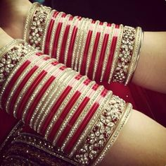 A very traditional Sikh wedding  necessity - the red chuda- but worn by most Indian brides today in different colored bangles.