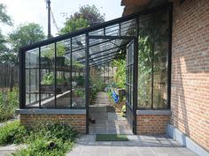 Authentic wrought iron conservatory as lean-to model on a low wall