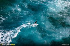 In the final days of summer, get lost in these stunning images of surfing: http://on.natgeo.com/1PJZXQT #YourShot