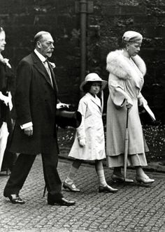 Princess Elizabeth of York (later Queen Elizabeth II) with her grandfather King George V and her grandmother Queen Mary.
