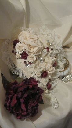Beautiful handmade heart of linen accented with antique lace, handmade flowers.