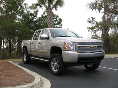 lifted silver  lifted Chevrolet Silverado truck