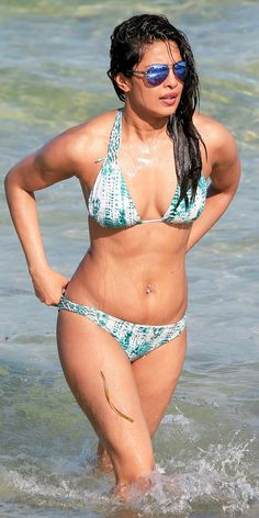Stars hit the beach in swimmingly good style. See all the best celebrity bathing suit photos here!