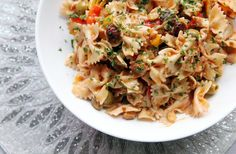 Special Request: Moroccan Pasta Salad from Caf� Madeleine at the Piper Palm House  Moroccan Pasta Salad is savory, not sweet, with plenty of warm, not hot, spices and a balance of salty olives, sweet dried fruit and wet, crunchy vegetables.  Click recipe here at end of article