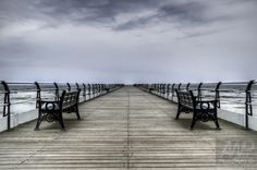 Pier of Symmetry by Andrew Wood - This photo is all about the symmetry of the pier and how it stretches out to the horizon. It gives the impression that it stretches out infinitely.