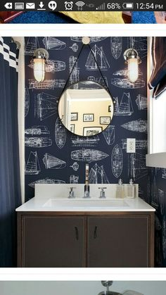 Needs white wainscoting to lighten up the small space, white towels held from hanging thick boat rope, round white frame around porthole mirror, twill drawstring blinds.