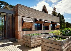 Mihaly Slocombe extends vineyard home in Australia with wooden nursery.