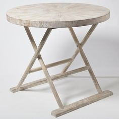 Our folding Loft Table is Inspired by the soft sandy hues of the seaside. The distinctive look of the Driftwood Collection is achieved by using individual precision-cut strips of mango wood. A sunburst pattern radiates from the center of the tabletop. Although a tour de force of carpentry, the effect is effortless and casual. To achieve this sun-bleached look, the piece is first lightened, then given a subtle creamy wash.