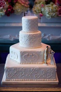 Traditional white Batman cake. …