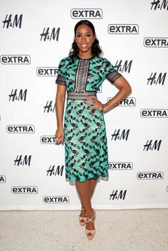 Kelly Rowland looks ultra glam in this green and black printed midi dress.   essence.com