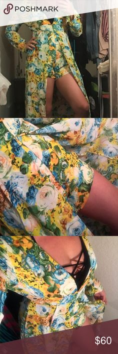 Floral Romper dress Gorgeous vibrant floral print romper dress. Sleeves can be buttoned and worn 3/4 sleeve. Plunging neckline (I styled with black caged bralette). Predominantly canary yellow with blue green and orange florals. NWT. Romper itself is lined so no worries of it being see through where you don't want it to be. Sleeves and dress part of the romper are sheer. So sexy for a vacation getaway!!!! Xtaren Pants Jumpsuits & Rompers