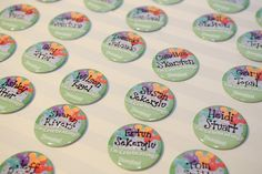 Disney buttons as escort cards // Paty and Travis' At Home Disney Wedding by Jim Kennedy Photographers // Inspired By Dis