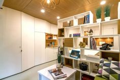arhiDOT design transformed a messy garage in Bucharest into a dream office. Visual Merchandising, Bucharest Romania, Lounge, Built In Cabinets, Design Furniture, Stores, Home Office, Liquor Cabinet, Bookcase