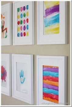 Kids' art gallery wall ~ in hallway between kids' rooms