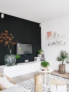 26 Great Living Room Design Ideas With Black Walls. 03 A Scandinavian Space Done In Neutrals And Creamy Shades And One Black Wall. The best collection of Great Living Room Design Ideas With Black Walls Feature Wall Living Room, Accent Walls In Living Room, Accent Wall Bedroom, Living Room Paint, Home Living Room, Living Room Designs, Living Room Decor, Tv On Wall Ideas Living Room, Black Feature Wall