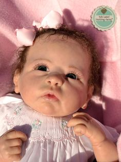 "This little darling is ILEANA. I created her as a custom order from Linda Murray's ""Chloe"" sculpt. She is 19"" long and weighs just over 5 lbs. She has incredibly realistic newborn skin, dark blue German glass eyes and chocolate brown hand-rooted Slumberland curls. Chloe lives in HEROUVILLE SAINT CLAIR, FRANCE. See her at www.heartstringsnursery.com"