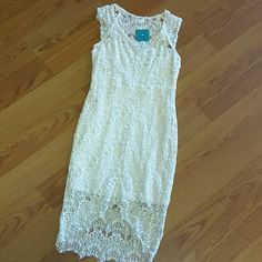 Free People lace dress Size XS, lined lace dress. Beautiful dress, front cut out center of hem.... Pic 4. Dress has very little stretch, please check your measurements. Armpit to armpit measures 13 inches across front. Bustline measures  12 inches across flat. Top of shoulder to back hem measures 37 inches. Front hem at its highest, to bottom hem is 7 inches. EUC. Raw edge hem at bottom hem and shoulder. Free People Dresses