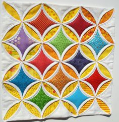 Cathedral windows by tramtadam, via Flickr - adding a different fabric to the inside of the intial square