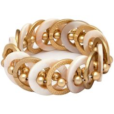 Mixit™ Gold-Tone Natural Shell Stretch Bracelet ($24) ❤ liked on Polyvore featuring jewelry, bracelets, mixit, seashell jewelry, shell bangles, goldtone jewelry and sea shell jewelry