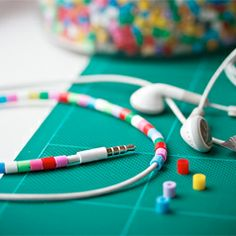 Earphones jazzed up with perler beads.  This would definitely distinguish mine (;