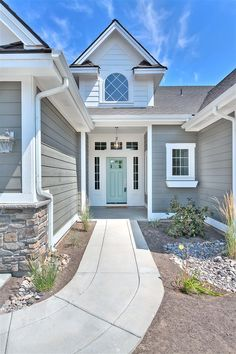exterior. benjamin moore amherst gray + wyeth blue door.