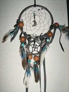 Dreamcatcher of the Black Moon,8 inch with a Crystal Quartz Point Charm handmade by the Dreamcatcherman by DreamCatcherMan on Etsy https://www.etsy.com/ca/listing/198275997/dreamcatcher-of-the-black-moon8-inch