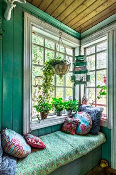 Quaint, Rustic Reading Nook with Cushions and Bird Cage