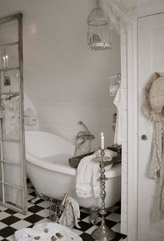 white shabby chic bathroom with a claw foot tub