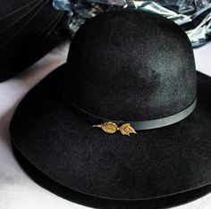 Rounded crown felt hat with feather badge.  Visit thesaucesuppliers.com for more felt hat style inspiration.