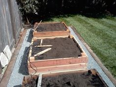 After yard design.new red wood 4x4,planter boxes,drip system,gravel.