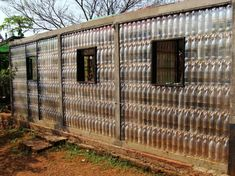 Amazing Ways to Reuse and Recycle Empty Plastic Bottles For Crafts 49 Plastic Bottle House, Empty Plastic Bottles, Recycled Bottles, Vertical Garden Diy, Unusual Buildings, Bottle Wall, Ways To Recycle, Friendly Plastic, Earthship