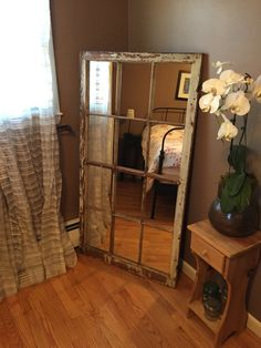 "Very rare 1870s antique 12 pane window from a house in Sutton Ma, repurposed into a full length mirror. Window once had a single peekaboo pane as well. Beautiful, shabby chic & original vintage patina on this 59"" x 33"" window."