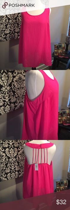 Torrid hot pink strappy back tank top Torrid hot pink strappy back tank top. New with tags, size 3X. Polyester. Button up closure in back. Elastic band along the top in back. torrid Tops Tank Tops