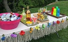 Hawaiian Luau Theme - this drinks table is the perfect example of a minimalist effect. A little bit of paper grass, some coloured flowers and cups, and your table is instantly recognisable as a Luau table. Aloha Party, Hawaiian Luau Party, Hawaiian Birthday, Luau Birthday, Adult Birthday Party, Birthday Party Themes, Hawaiian Theme, Adult Luau Party, Hawaiian Baby